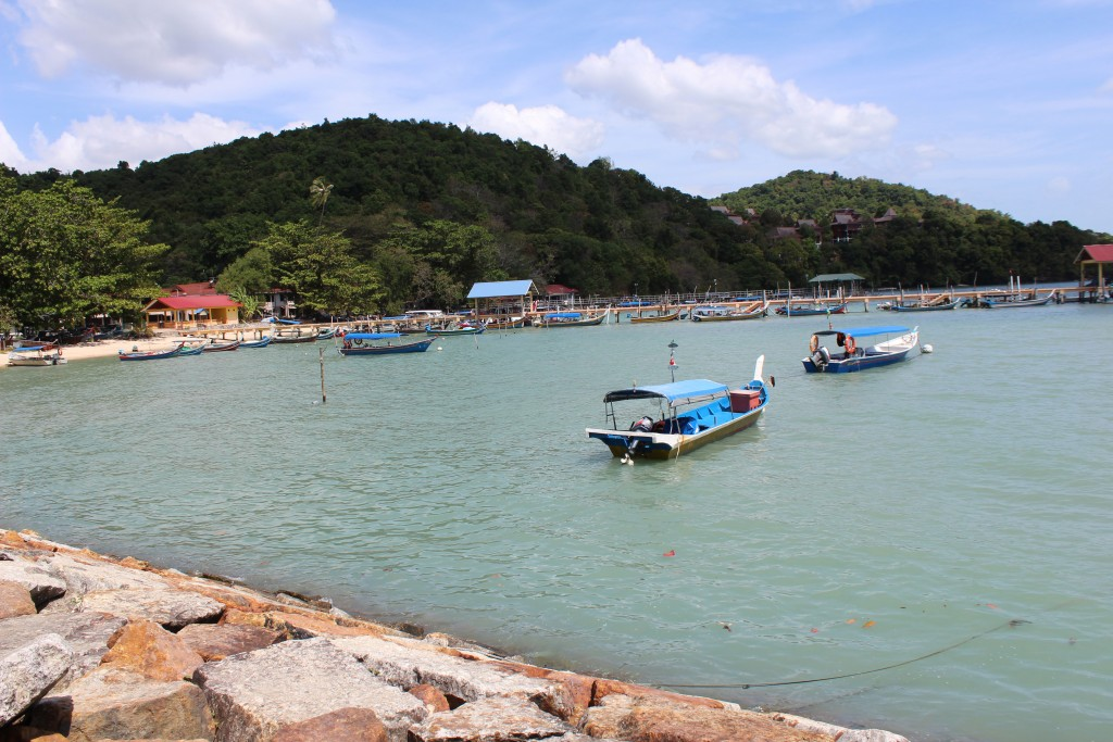 A village near the jetty. Many Malay long boats were docked here.