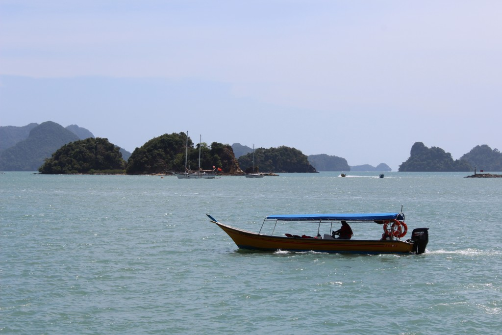 Some of the long boats, like this one, were fishing boats. You can see the myriad islands in the background.