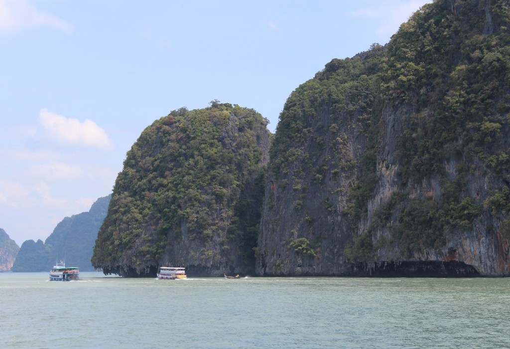 Most of the islands featured steep tree covered cliffs with eroded limestone near the bottom.