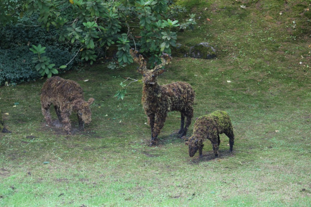 Some deer made of moss.