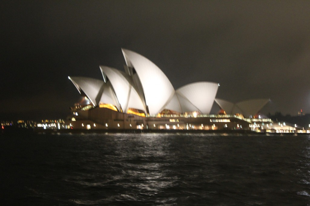 The Sydney Opera House at night seen from the other side of the bay.