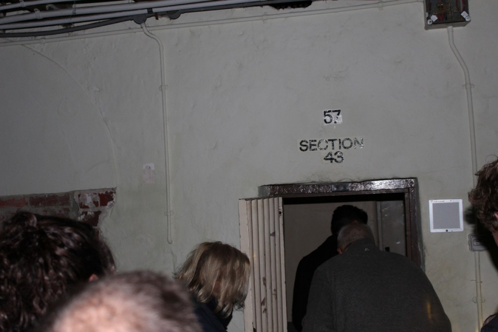 Visitors enter a cell.